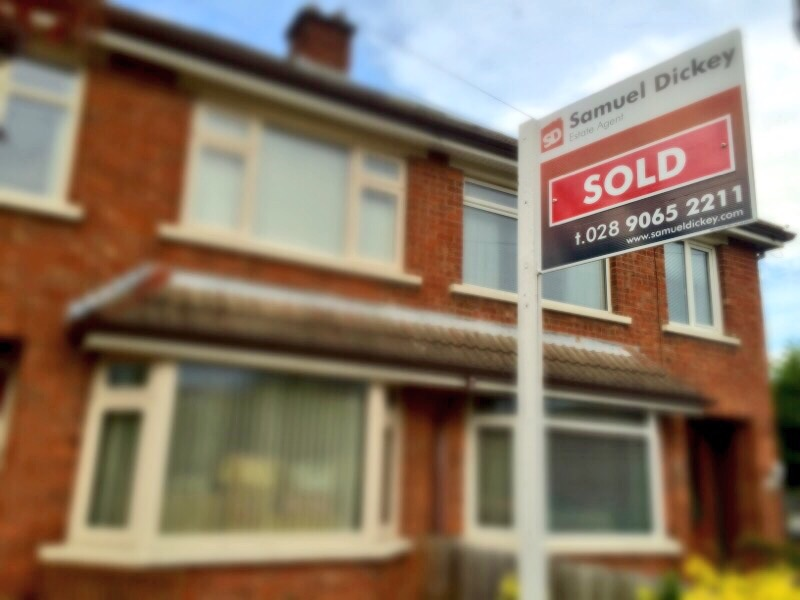 A sold sign outside a semi-detached house Belfast