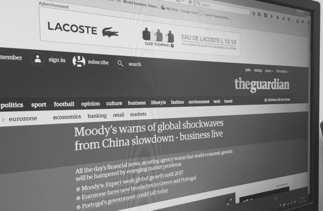 Photo of the Guardian website on a screen with a news story about the slowdown in China